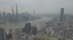 Aerial flight towards Pudong financial center and Bund in Shanghai Stock Footage