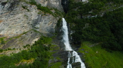 Aerial Shot of Beautiful Waterfall in Rocky Mountains Covered with Forest Stock Footage