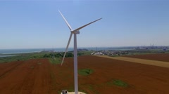 Aerial view of a white wind turbine by the sea with a view of the water Stock Footage