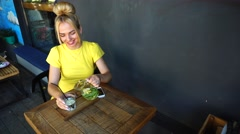 Beautiful female smile in cafe,sitting table Stock Footage