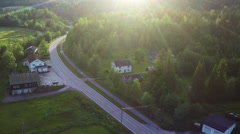 Aerial Shot of Coutry Road Surrounded by Forest Stock Footage