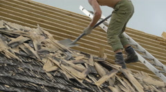 The roofer removing the old wooden shingles Stock Footage