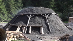 4k Charcoal burner smoking charcoal pile scenery Stock Footage