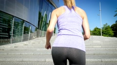 Female running up stairs time delay Stock Footage