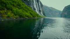 Beautiful Landscape of River Surrounded by Large Steep Mountains and Cliffs Stock Footage