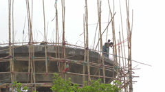 Labours demolishing a high concrete structure with drill machine. Stock Footage