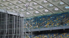 Working raise rope standing in a construction ladder on the big stadium Stock Footage