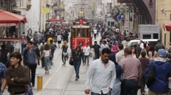 Nostalgic tramway passing through Istiklal Street Stock Footage