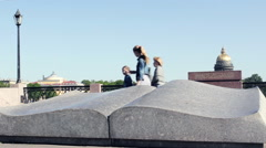 People Passing by  Symbol of Knowledge - Stone Monument Book Stock Footage