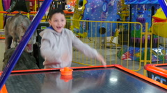 4k, emotional little boy playing in air hockey in entertainment center 2 Stock Footage