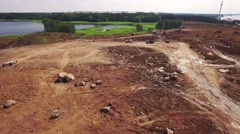 Aerial view on building site in nature with brown ground and big rocks Stock Footage