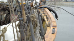 The ropes and metal bars on the side of the ship Stock Footage