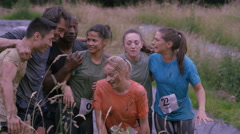 4K Portrait happy smiling mud race runners at end of race Stock Footage