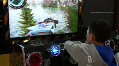 4k,boy play in video game on special simulator in entertainment center 4 Stock Footage