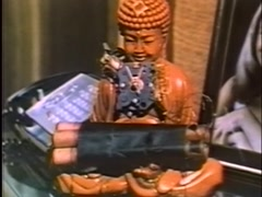 Wide shot of  time bomb attached to Buddha statue, 1970s Stock Footage
