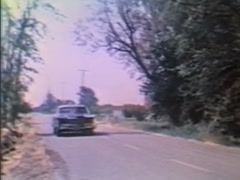 1967 Cadillac Eldorado turning into driveway of country home, 1970s Stock Footage
