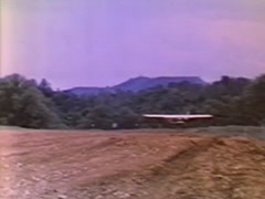 Wide shot of Cessna 150 turning on open field, 1970s Stock Footage