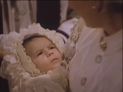 Twins held by parents during christening, 1940s Stock Footage