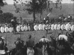 Transition shot of tribal war dance in field, 1940s Stock Footage