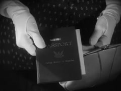 Medium shot of woman handing over passport to official, 1930s Stock Footage