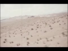 Tracking shot of Mojave Desert from helicopter, 1970s Stock Footage