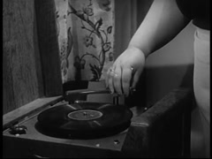 Woman turning off record player, 1940s Stock Footage