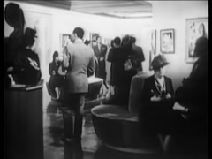 WIde shot of people looking at paintings in museum, 1940s Stock Footage