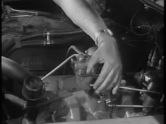 Close-up of  man working on car accelerator,1960s Stock Footage