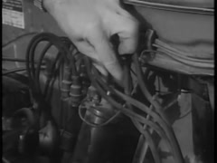 Close-up of man inserting leads into distributor cap, 1960s Stock Footage