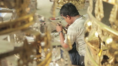 Close-up of Gold Plated Hti Used on Burmese Pagodas in Mandalay Factory Stock Footage