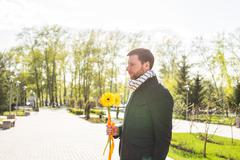 Man with flower waiting his woman - the romantic date or valentines day concept Stock Photos