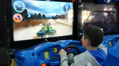 4k,boy play in video game on special simulator in entertainment center 2 Stock Footage