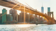 Time-lapse of boats crossing under the Brooklyn Bridge Stock Footage