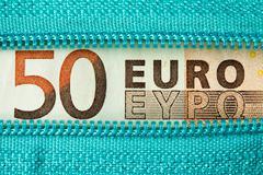 Fifty Euro and zipper Stock Photos