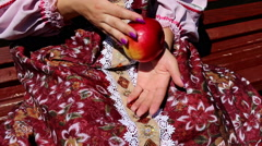 Apples, women's hands, and dress Stock Footage