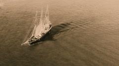 Sailing retro pirates historic cargo ship boat ocean sea. Aerial HD video cepia Stock Footage