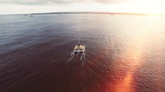 Yacht - Catamaran in the tropical sea at sunset. Yachting / Luxury Sailing theme Stock Footage