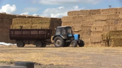 Tractor And Hay Bales Stock Footage