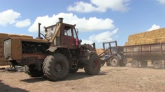 Tractor And Trailer With Hay Bales In Rural Landscape  Stock Footage