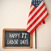 Text happy labor day and American flag Stock Photos