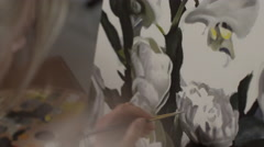 Woman painting on canvas Stock Footage