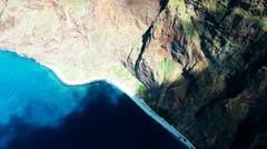 Flight aerial over rugged coastline, surf water ocean sea, cliff coast 4k video Stock Footage