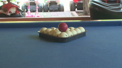 Slider shot of pool balls racked with cue ball ready Stock Footage