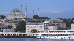 Ferry boats in river near cityscape in Istanbul Stock Footage