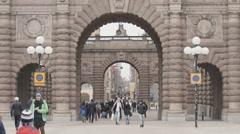 Tourists walking entrance gate of Riksdagshuset Stock Footage