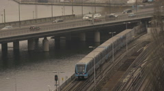 Train and vehicles moving on bridge in Stockholm Stock Footage