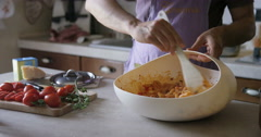 Close up of hands mixing together pasta dish Stock Footage