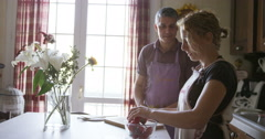 Italian couple prepping dinner together Stock Footage