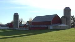 Establishing shot of a Wisconsin dairy farm as cows enter the barn. Stock Footage