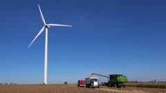 Giant windmills turn near a rural Midwestern farm. Stock Footage